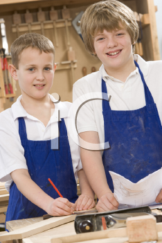 Royalty Free Photo of Students in Woodworking