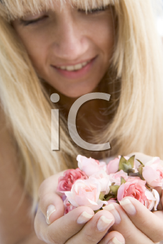 Royalty Free Photo of a Woman Holding a Handful of Roses