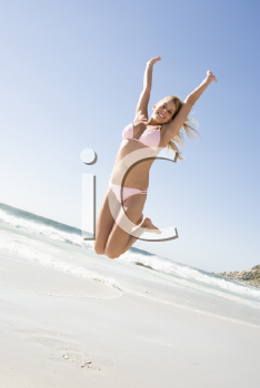 Royalty Free Photo of a Girl Jumping at the Beach