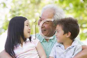 Royalty Free Photo of a Man With His Grandchildren