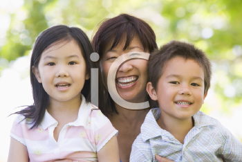 Royalty Free Photo of a Woman With Her Grandchildren