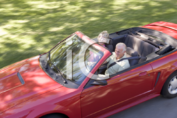 Royalty Free Photo of a Couple in a Convertible