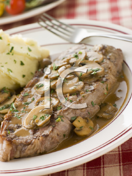 Royalty Free Photo of Steak Sirloin with Sauce and Mashed Potato