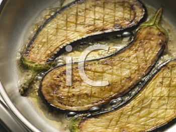 Royalty Free Photo of a Eggplant Frying Oil