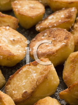 Royalty Free Photo of Tray of Roasted Potatoes with Sea Salt