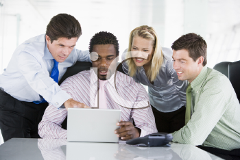 Royalty Free Photo of a Group of People Around a Laptop