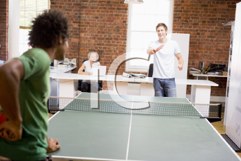 Royalty Free Photo of Men Playing Ping Pong