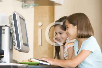 Royalty Free Photo of Two Girls at a Computer