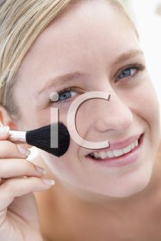 Royalty Free Photo of a Girl With a Makeup Brush