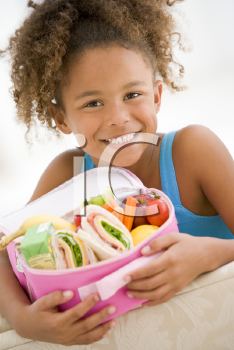 Royalty Free Photo of a Girl With Her Lunchbox