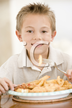 Royalty Free Photo of a Boy Eating Fish and Chips