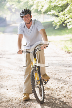 Royalty Free Photo of a Guy on a Bike