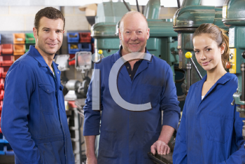 Royalty Free Photo of Three Machinists
