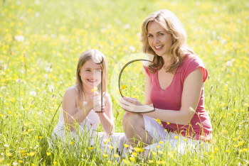 Royalty Free Photo of a Mother and Daughter Picking Flowers