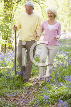 Royalty Free Photo of a Couple Walking Outdoors