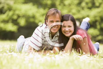 Royalty Free Photo of a Couple Lying Outdoors