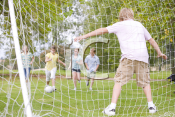 Royalty Free Photo of Friends Playing Soccer