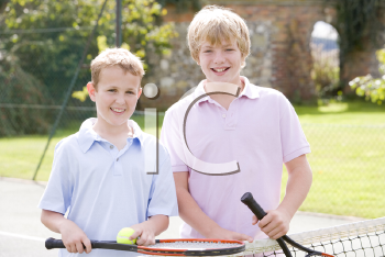 Royalty Free Photo of Two Boys on a Tennis Court