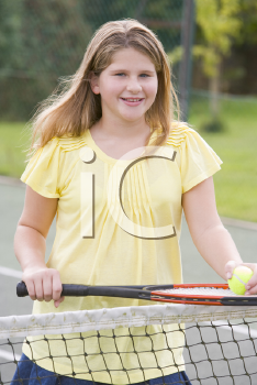Royalty Free Photo of a Girl With a Tennis Racket