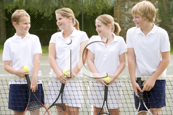 Royalty Free Photo of Kids on a Tennis Court