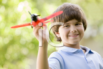 Royalty Free Photo of a Boy With a Toy Airplane