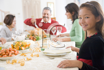 Royalty Free Photo of a Family Having Christmas Dinner