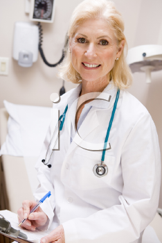 Royalty Free Photo of a Female Doctor With a Clipboard