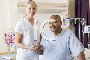 Royalty Free Photo of a Nurse Helping a Patient