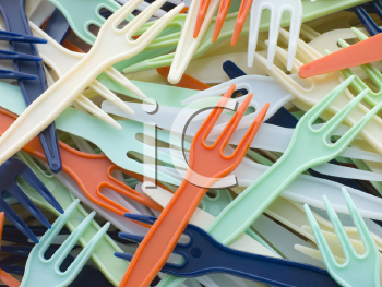 Royalty Free Photo of a Pile of Coloured Plastic Forks
