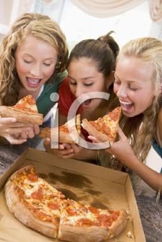 Royalty Free Photo of Girls Eating Pizza