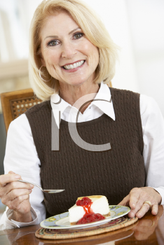 Royalty Free Photo of a Woman Eating Cheesecake