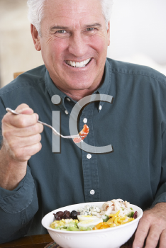 Royalty Free Photo of a Man Eating a Salad