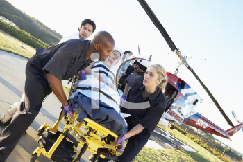 Royalty Free Photo of a Patient Being Taken From an Air Ambulance