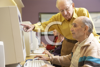 Royalty Free Photo of Group of Seniors on Computers