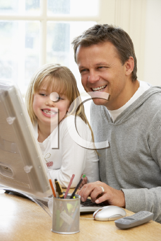 Royalty Free Photo of a Father and Daughter Using the Computer