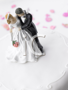 Royalty Free Photo of a Wedding Cake With Figurines