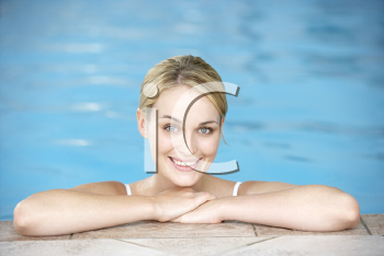 Royalty Free Photo of a Young Woman in a Pool