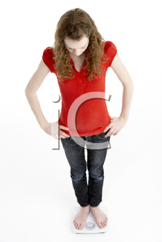 Royalty Free Photo of a Girl on Scales
