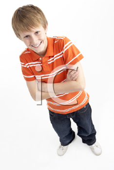Royalty Free Photo of a Boy Standing With Arms Crossed