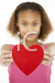 Royalty Free Photo of a Little Girl Holding a Heart