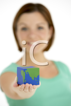 Royalty Free Photo of a Woman Holding a Cubed Globe
