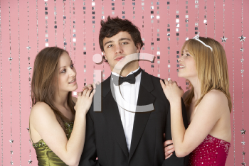Royalty Free Photo of Two Girls With a Boy at a Party