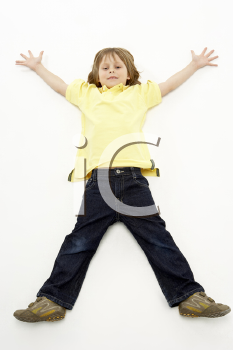 Studio Portrait of Smiling Boy lying down with arms and legs spread