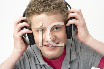 Royalty Free Photo of a Boy Listening to Music