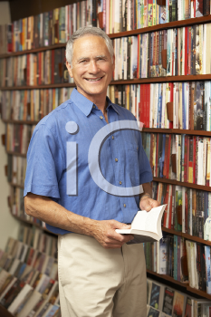 Royalty Free Photo of a Man in a Bookshop