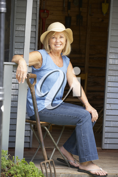 Senior woman sitting on veranda