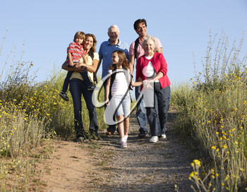 Multi-generation family on country walk