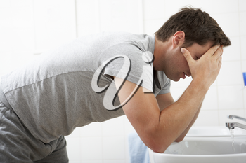 Tired Man In Standing At Bathroom Sink