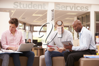 College Student Having Meeting With Tutor To Discuss Work