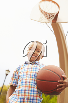Portrait Of Boy On Basketball Court